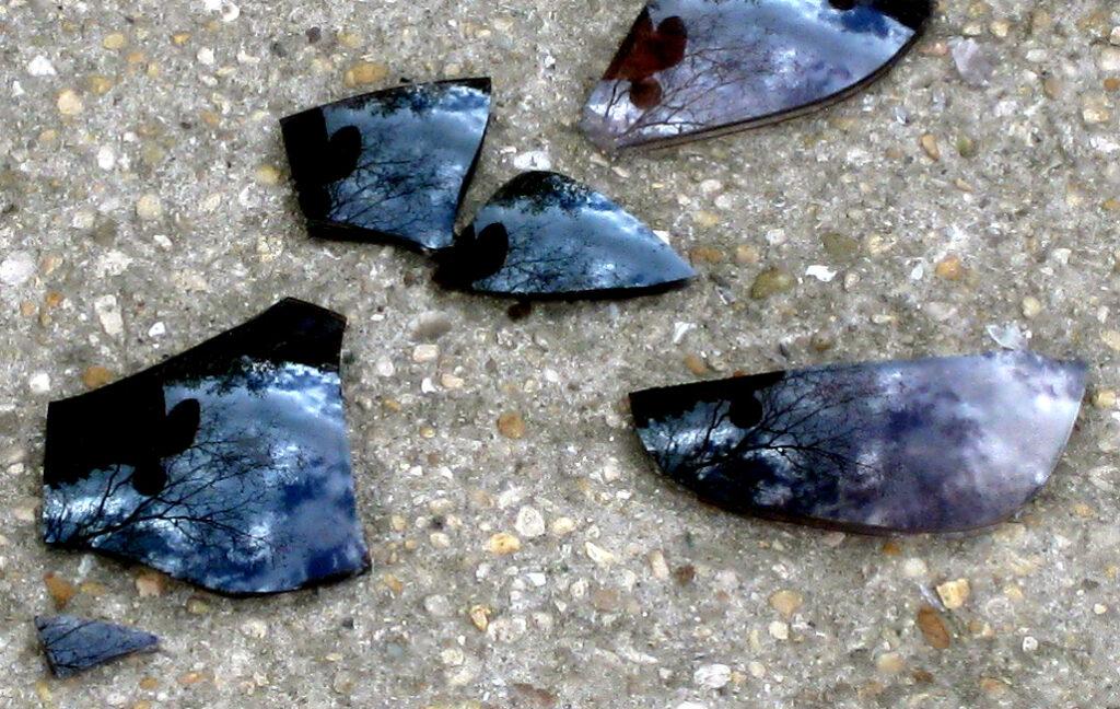 Broken sunglass and reflection