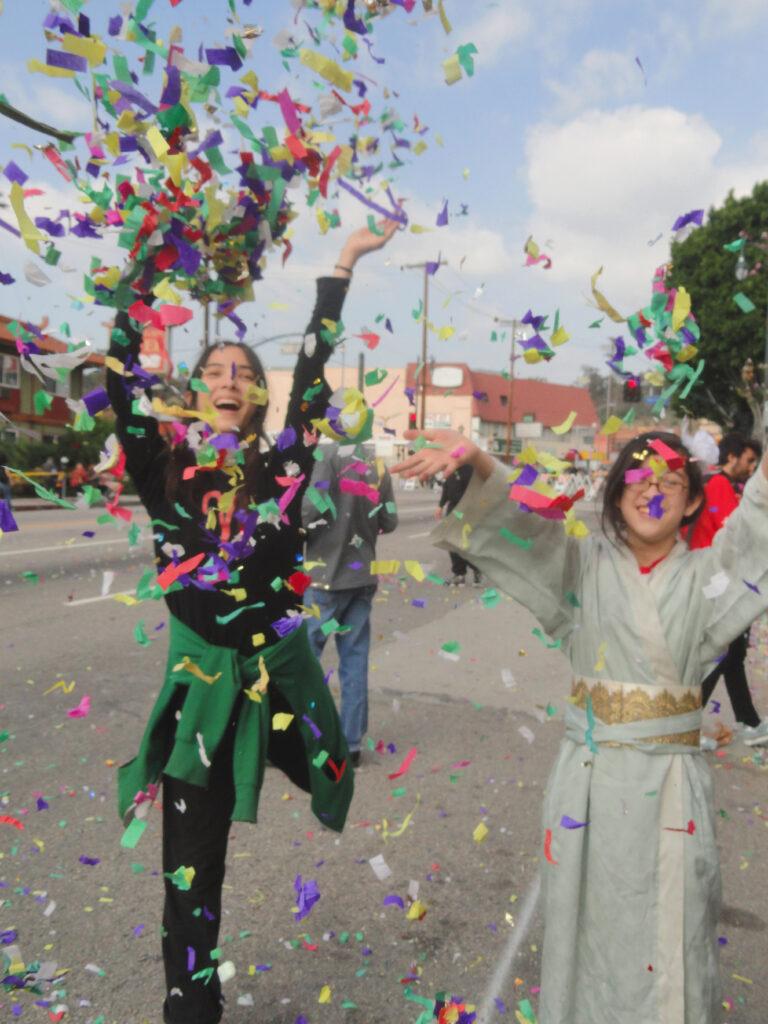 Children tossing confetti