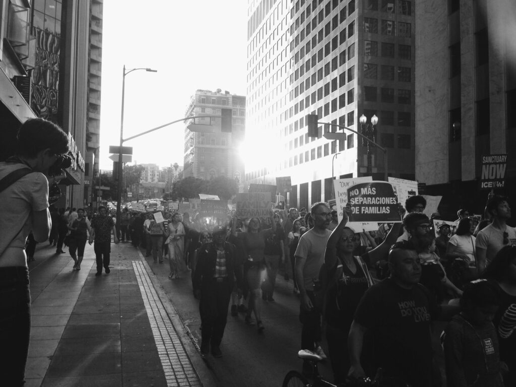 Black and white photo of people marching